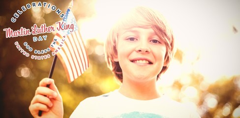 Composite image of low angle view of boy with american flag