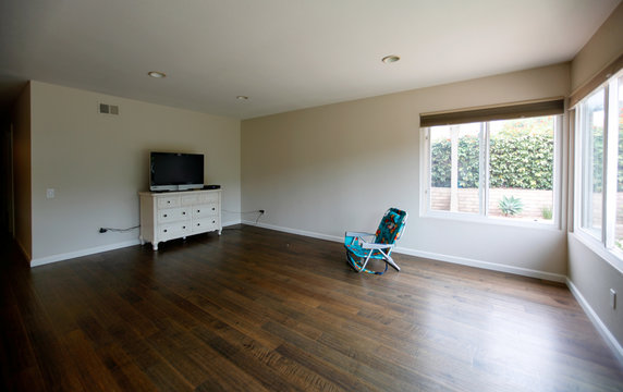 A chair and television are all that furnish the living room of their new home after a military family was forced to move out of their mold-infested military housing at Camp Pendleton to off-base housing in Carlsbad