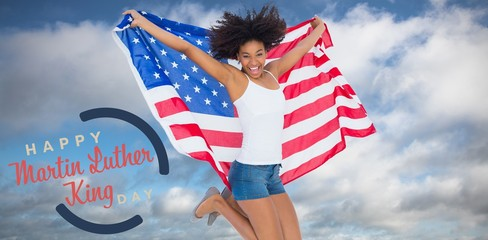 Composite image of pretty girl wrapped in american flag jumping