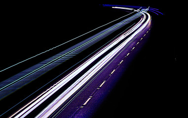 Abstract light trails on highway at night
