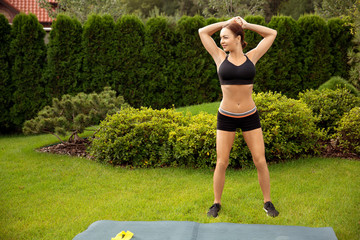Strong beautiful sporty female doing the workout outdoor. Woman, sport, health, lifestyle concept
