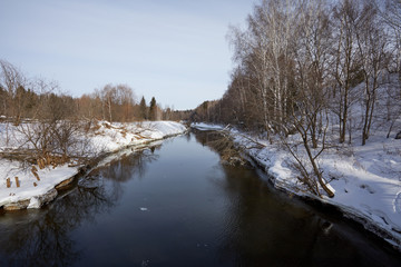 Beautiful winter landscape with river and snow. Sunny frosty day