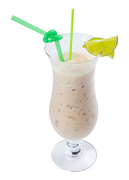 apple smoothie decorated with lime. refreshing drink in tall glass with ice and green straw