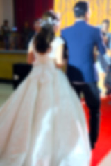 Blur groom and bride go to stage