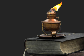 Oil lamp on old bible