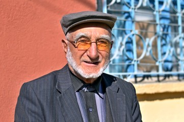 close-up portrait of happy senior man looking at camera. Elderly Turkish Man Portrait who lives in a small town of Turkey.
