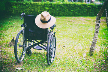 Wheelchair with hat for old elder patient cannot walk or disable people use in home or hospital : healthy strong medical concept.  Wall mural