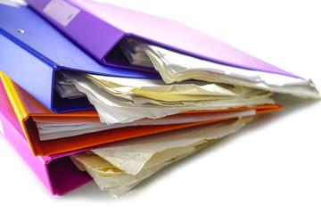 File Folder Binder stack of multi color on table in office.