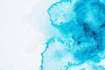 abstract bright blue and turquoise paint blots on paper