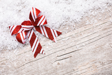 Holiday: Christmas Gift Bow On Snowy Background