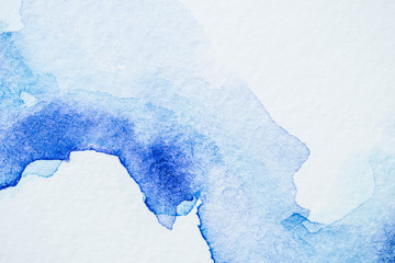 creative blue watercolor painting on white paper