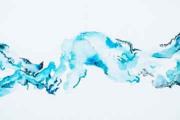 abstract bright blue watercolor blots on paper
