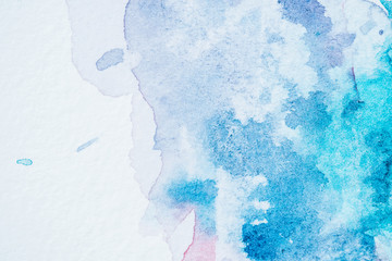 abstract bright blue watercolor blots on paper textured