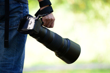 Photographer holding a camera in a refreshing atmosphere in the morning