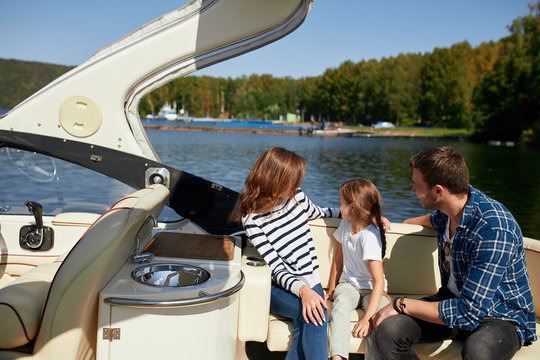 Family with daughter spending time together on sailboat