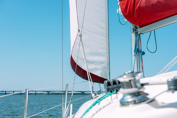 Sail of a sailing boat against blue sky
