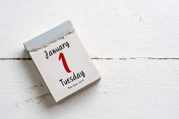 tear-off calendar with 1st of january 2019 on white wooden background