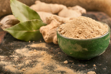 Ginger and ginger powder with laurel leaves
