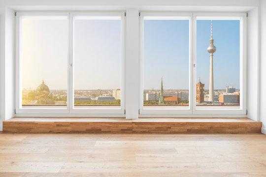 Berlin skyline through terrace windows - modern penthouse apartment  room
