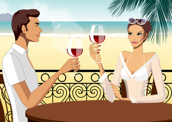 Couple toasting wine at table