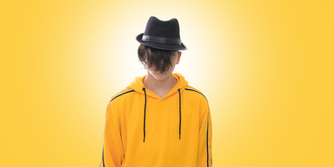 young fashioned teenager isolated in yellow background