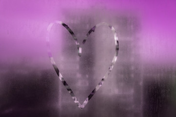 Heart painted on misted glass. 3
