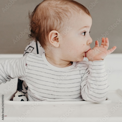 Close up of a cute baby boy sucking thumb