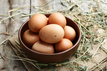 raw chicken eggs in a plate