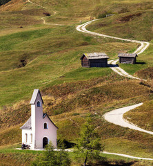 Nature landscape with nice church in a mountain pass in Italy Alps.