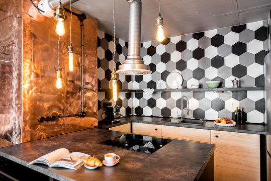 Modern loft kitchen room made in pink and grey colors with copper wall and hexagonal tiles