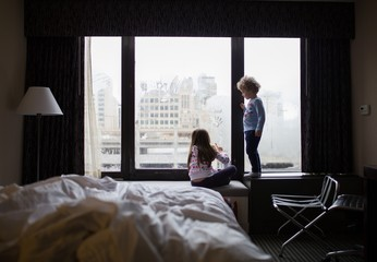 Children playing near window in the hotel room