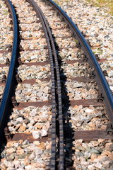 Close-up of a railroad track with a rack.