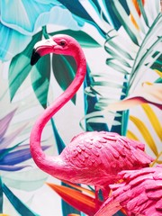 Close up pink flamingo decorated with tropical graphic background