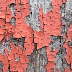 Red old paint flaked on wood