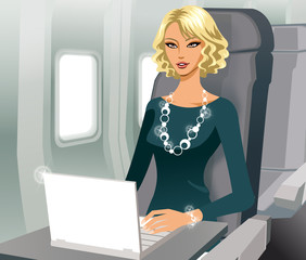 Business woman working with laptop in airplane