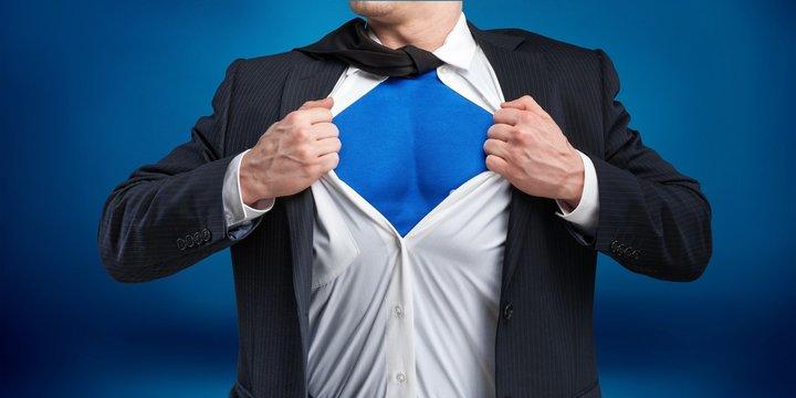 Businessman tears shirt on himself to show