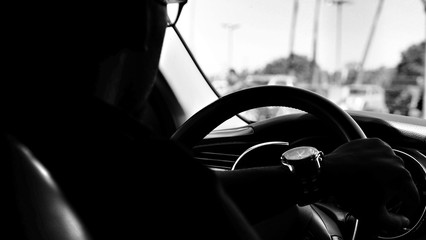 Close up of man driving a car