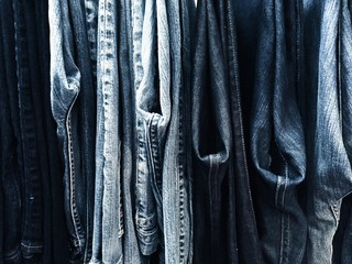 Close up of denim jeans hanging in the wardrobe