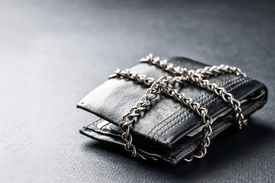 The concept of the wallet is locked with a chain