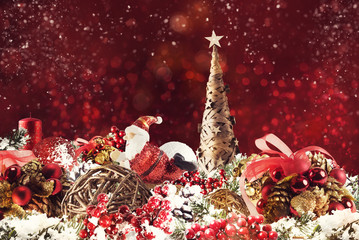 Christmas background concept. Shimmering Christmas decorations with tree, Santa Claus and candles