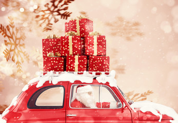 Santa Claus on a red car full of Christmas present with snowflakes background drives to deliver