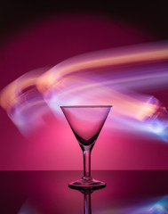 Martini glass on the background of neon lights