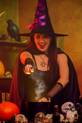 Image of witch in black hat with outstretched hand with magic wand