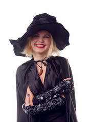 Portrait of witch blonde in black hat with arms crossed