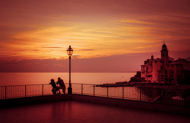 Couple admires the sunset on the sea
