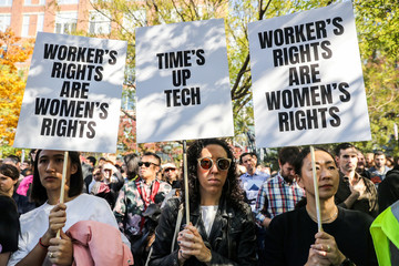 Workers hold signs outside 14th Street Park across the Google offices after walking out as part of a global protest over workplace issues in New York