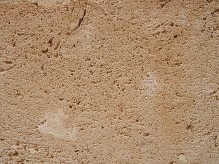 a rough light brown porous textured sandstone flat surface background