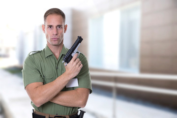 security agent with green shirt guarding a building