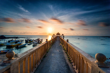 Beautiful long exposure sunrise shot at jetty. Image contain certain grain or noise and soft focus when view at full resolution