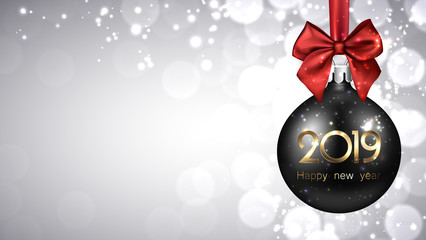 Grey 2019 New Year background with black Christmas ball.